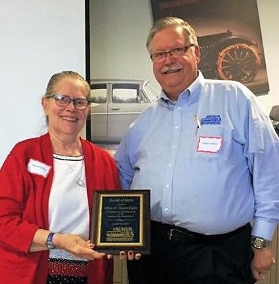 Sharon Ogden Accepts award from David Schmidt